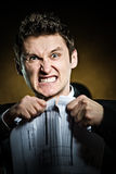 Angry businessman tearing document Royalty Free Stock Photo