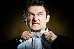 Angry businessman tearing invoice Royalty Free Stock Image