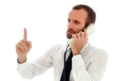 Angry businessman at the telephone royalty free stock image