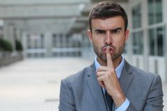 Angry businessman telling you to shut up Royalty Free Stock Image