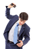 Angry businessman throwing  his mobile phone. Isolated on white background Stock Image