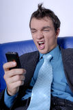 Angry Businessman To Phone Stock Images