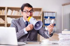 The angry businessman with too much work in office Royalty Free Stock Image