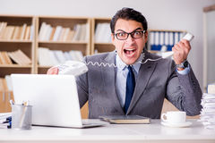 The angry businessman with too much work in office Royalty Free Stock Photos