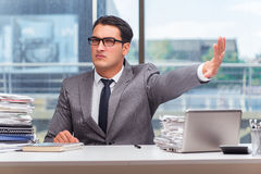 The angry businessman with too much work in office Stock Photo