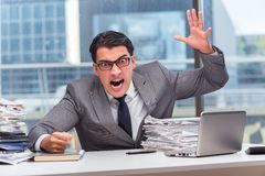 The angry businessman with too much work in office Stock Photos