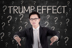 Angry businessman with Trump Effect word Stock Photos