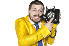 Angry businessman trying to choose a phone number Stock Photo