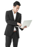 Angry businessman using a laptop Royalty Free Stock Photo