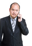 Angry businessman using mobile Royalty Free Stock Image