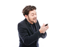 Angry businessman using smartphone Royalty Free Stock Photos