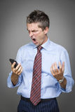 Angry businessman Stock Images