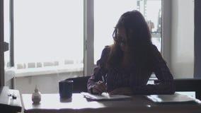 Angry businessman wearing eyeglasses throwing paper, having nervous breakdown at work, losing temper, slow motion. Angry businessman throwing paper, having stock footage