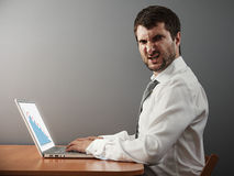 Angry businessman working with laptop. And looking at camera Royalty Free Stock Image