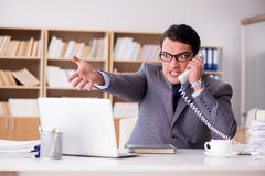 The angry businessman working in the office Stock Photography