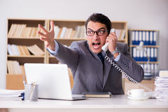 The angry businessman working in the office Royalty Free Stock Images