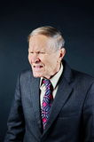 Angry businessman. Yelling on black background Royalty Free Stock Photo