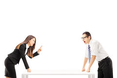Angry businessman yelling at businesswoman who is threatening. Isolated on white background Royalty Free Stock Image