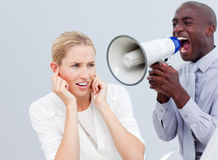 Angry businessman yelling through a megaphone Stock Photo