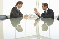 Angry Businessmen At Conference Table Royalty Free Stock Image