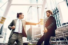 Angry businessmen push competitor from maket share in imagine. Business marketing and Teamwork idea concept. Soft and split cross. Angry businessmen push stock photography