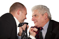 Angry businessmen tearing at their ties Stock Images