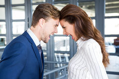 Angry businesspeople standing head to head Stock Images