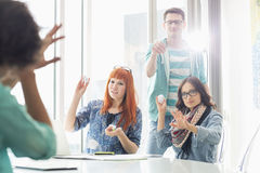 Angry businesspeople throwing paper balls on colleague in creative office royalty free stock photos