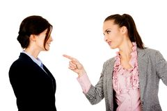 Angry businesswoman accuses her partner. Beautiful angry businesswoman accuses her partner Royalty Free Stock Photo