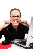 Angry businesswoman biting a cable Stock Image