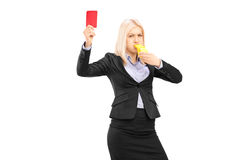 Angry businesswoman blowing a whistle and showing a red card. Isolated on white background Stock Photography