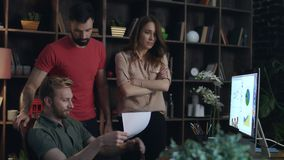 Angry businesswoman boss shaking paper documents near manager face. Furious woman boss unhappy with bad work of business team at office meeting. Business stock footage