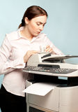 Angry businesswoman with copier and cup of coffee Royalty Free Stock Photography