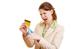 Angry businesswoman cutting Stock Images