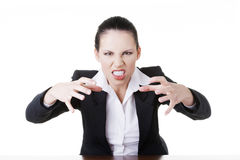 Angry businesswoman at the desk Royalty Free Stock Image