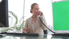 Angry businesswoman ending a call. In an office stock video