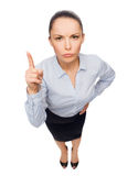 Angry businesswoman with finger up Stock Photo
