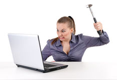 Angry businesswoman with hammer and laptop Royalty Free Stock Image