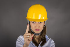 Angry businesswoman with helmet Royalty Free Stock Photography