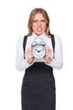 Angry businesswoman holding the clock Stock Image