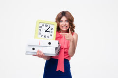 Angry businesswoman holding clock and folders Royalty Free Stock Image