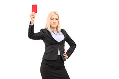 Angry businesswoman holding a red card. Isolated on white background Royalty Free Stock Image