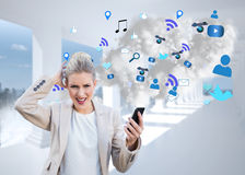 Angry businesswoman holding smartphone with cloud computing graphic Stock Image