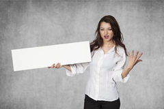 Angry businesswoman holds a copy space Stock Images