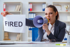 The angry businesswoman issuing termination notice Stock Photos