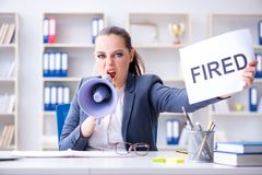 The angry businesswoman issuing termination notice Stock Photography