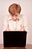Angry businesswoman with a laptop Royalty Free Stock Images