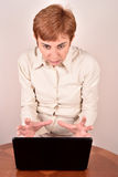 Angry businesswoman with a laptop Royalty Free Stock Image