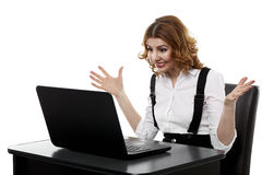 Angry businesswoman at laptop Stock Photo