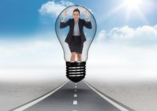 Angry businesswoman in light bulb over road Royalty Free Stock Photography